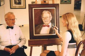 Dr. Wilson Greatbatch and I pose with the portrait I painted of him.