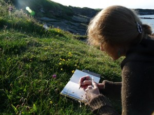 Me Drawing near Cullernose Point 27 re 300x225 Nature Journaling Class   April 2011