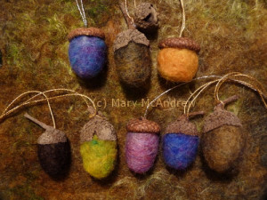 Colorful wool needle felted acorns, caps from two different oak trees.